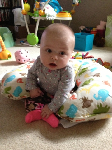 Sitting up on her own