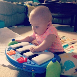 Playing piano and learning to sit