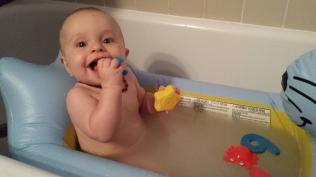She loves baths (this was an oatmeal bath)