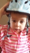 Her new helmet. It has kitties all over it.