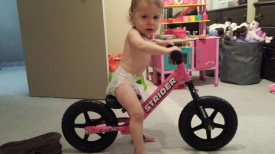 Liv trying out her new Strider bike.