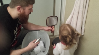 Watching her daddy about to shave off his entire beard.